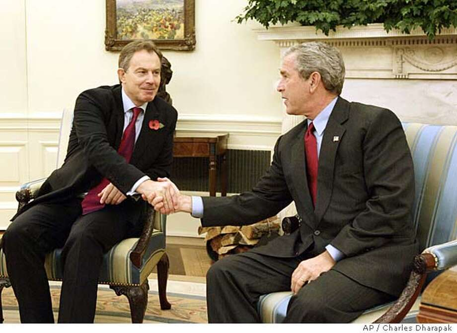 President Bush, right, meets with Britain's Prime Minister Tony Blair in the Oval Office of the White House Friday, Nov. 12, 2004 in Washington. (AP Photo/Charles Dharapak) Photo: CHARLES DHARAPAK