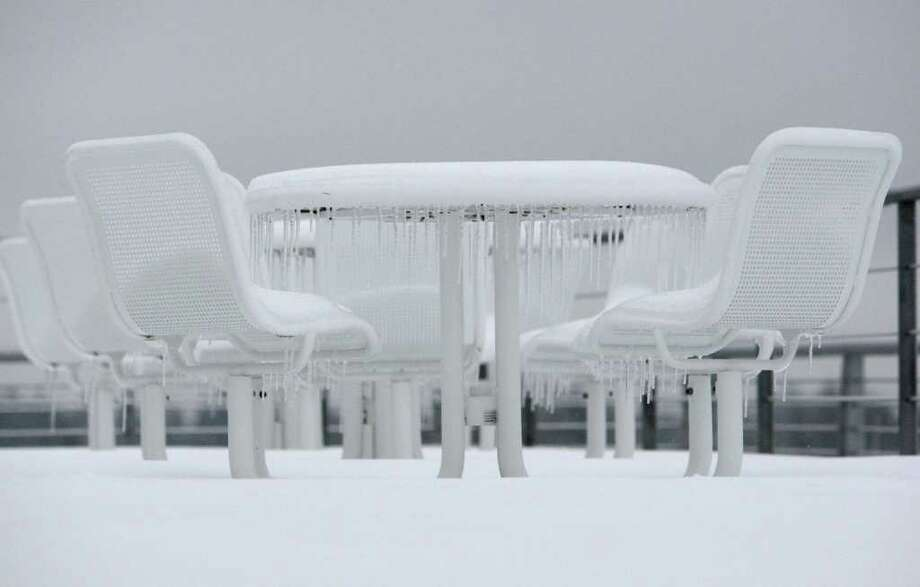 A table is frozen at Seattle-Tacoma International Airport on Thursday, January 19, 2012. Crews used de-icer, plows and brooms to keep the airport operating after an early morning closure. Photo: JOSHUA TRUJILLO / SEATTLEPI.COM