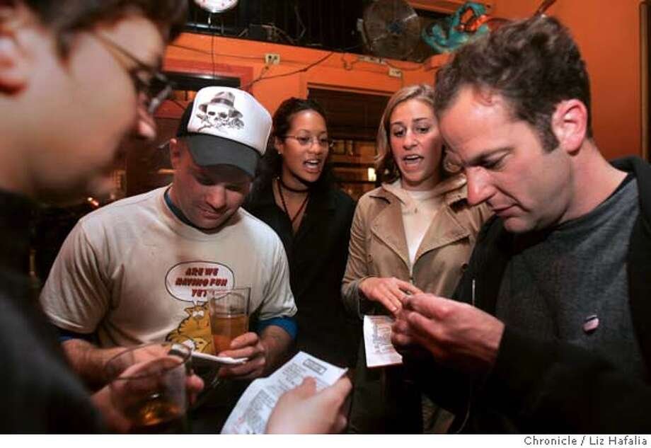 "BARNIGHT13_040_LH.JPG  Rebecca Dankner (back, left) and Sunne Smith (back,right) giving DUI literature to clockwise seated--Melissa Stern, Tony Montana (skull hat) and John Meggitt (right). Sorority girls from UC Berkeley are going on a San Francisco pub crawl to hand out information on the high costs of getting a DUI. The activity is called ""Bar Nights"" and is put on by the public health department and the police department. � Shot on 11/11/04 in San Francisco. LIZ HAFALIA/The Chronicle MANDATORY CREDIT FOR PHOTOG AND SF CHRONICLE/ -MAGS OUT Metro#Metro#Chronicle#11/13/2004#ALL#5star##0422463275 Photo: Liz Hafalia"