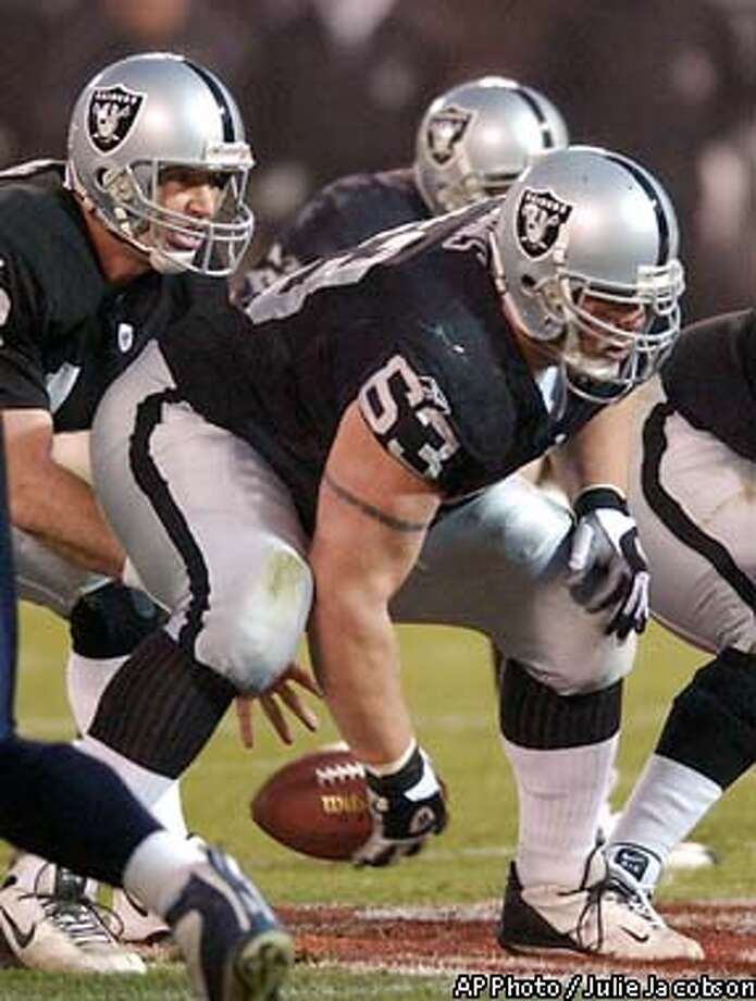 ** FOR USE ANYTIME WITH 2003 SUPER BOWL STORIES ** Oakland Raiders center Barret Robbins snaps the ball back to quarterback Rich Gannon during the fourth quarter of the AFC Championship game against the Tennessee Titans in this Jan. 19, 2003 file photo in Oakland, Calif. The Raiders sent All-Pro center Barret Robbins home from the Super Bowl for unspecified violations, the team confirmed Sunday, Jan. 26. 2003. (AP Photo/Julie Jacobson) Photo: JULIE JACOBSON