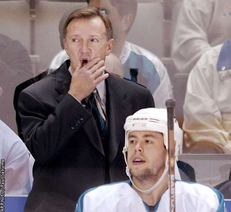 San Jose Sharks coach Ron Wilson watches action with left wing Marco Sturm, foreground, during the second period against the Anaheim Mighty Ducks, Thursday, Jan. 30, 2003, in San Jose, Calif. Wilson was the first coach for the Mighty Ducks. (AP Photo/Paul Sakuma) Photo: PAUL SAKUMA