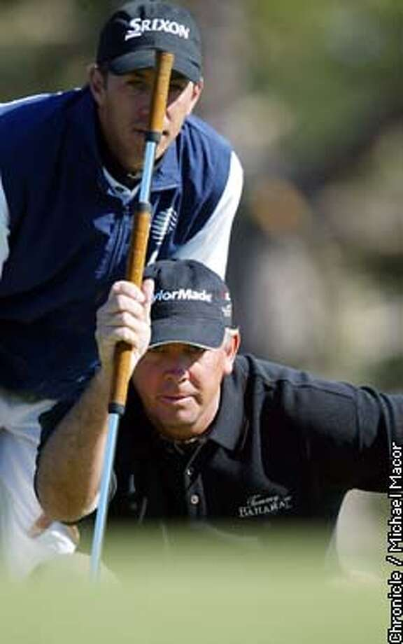 Tom Lehman lines up a putt on the 10th hole at Spyglass Hill, with help from his caddie Tom Kalinowski. Lehman at 8 under for the tournament. 3rd round of the Pebble Beach Pro-Am Feb. 8,2003. by Michael Macor/The Chronicle Photo: MICHAEL MACOR