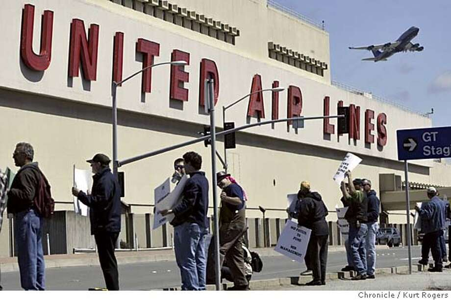 United Airlines employees held a demonstration in front of the maintenance facility at the San Francisco airport. as a United 747 takes off in the background.  United Airlines has asked a bankruptcy judge to make changes in the company's pension plan that could cut payments to people who retire from the company. The judge may reach a decision today. 5/10/05 in San Francisco,CA.  KURT ROGERS/THE CHRONICLE Photo: KURT ROGERS
