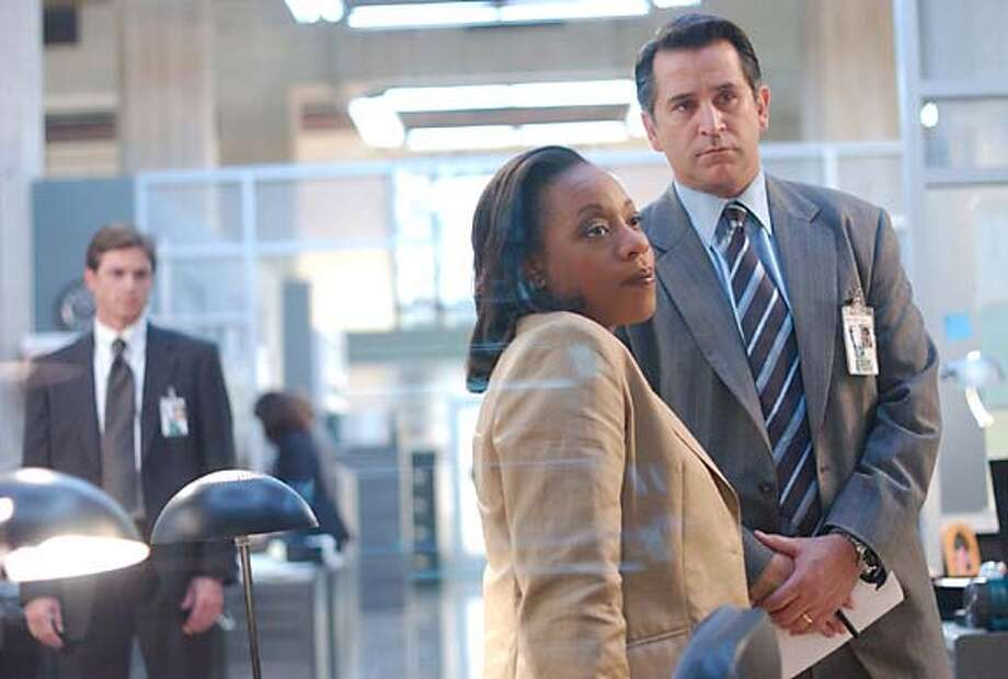 "Anthony LaPaglia, right, Marianne Jean-Baptiste and Eric Close star in ""Without a Trace."""