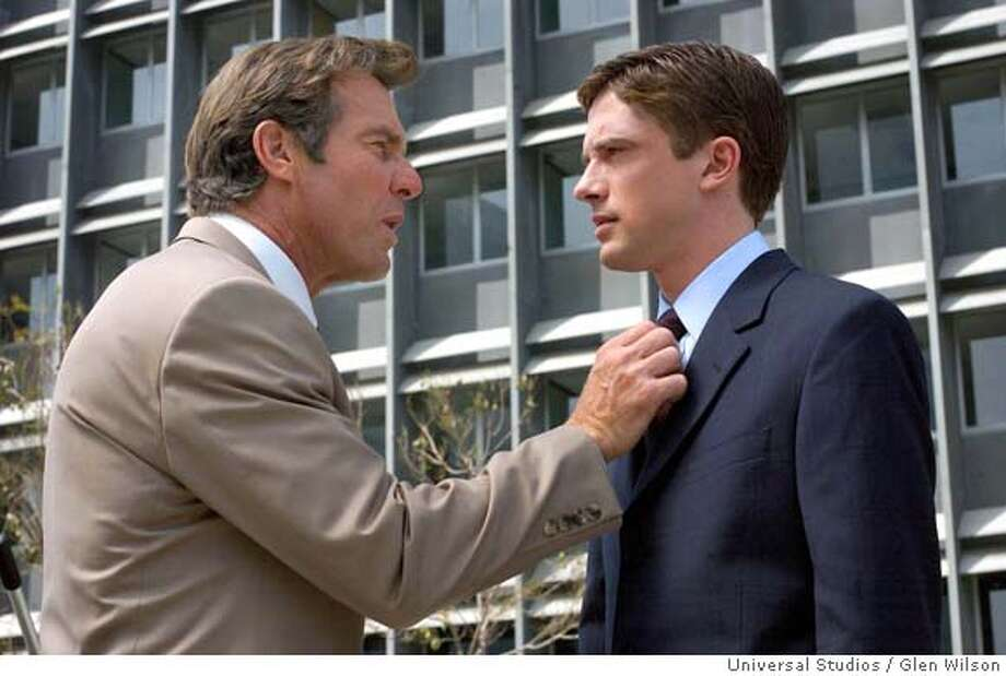 "In this photo provided by Universal Studios, Dan Foreman (Dennis Quaid, left) and his boss, Carter Duryea (Topher Grace) , in the comedy "" In Good Company."" (Universal Studios / Glen Wilson) Ran on: 01-09-2005  Dennis Quaid and Topher Grace are uneasy colleagues in &quo;In Good Company.&quo; Ran on: 01-14-2005  Dennis Quaid confronts Topher Grace, the executive who replaces him -- and sleeps with his daughter -- in &quo;In Good Company.&quo; Photo: GLEN WILSON"
