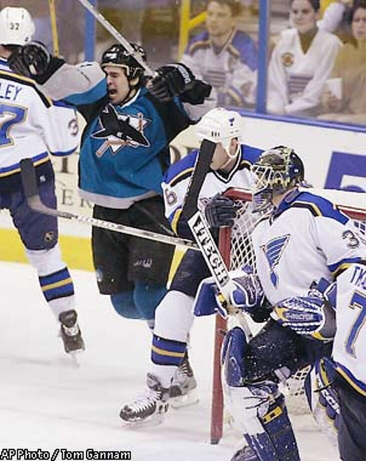 San Jose Sharks' Jonathan Cheechoo, second from left, celebrates his first-period goal as St. Louis Blues goalie Brent Johnson, right, looks on Saturday, Feb. 8, 2003, in St. Louis. (AP Photo / Tom Gannam) Photo: TOM GANNAM