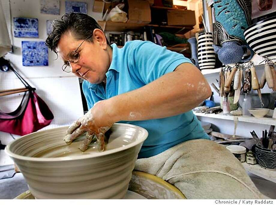 CRAFTSWOMEN_rad.jpg Eileen Goldenberg is an artist in San Francisco--she is shown throwing a ceramic vessel on her potters wheel in her Susset District studio. She does ceramics and encaustic painting (wax painting). She will be exhibiting her work at the 26th annual Celebration of Craftswomen Fair. Susan Fornoff is writing for the Home section. Katy Raddatz / The Chronicle Photo: Katy Raddatz