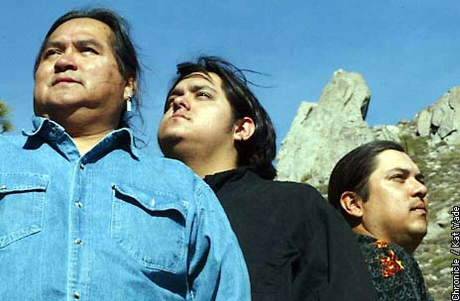 "Members of the Ewiiaapaaye (Cuyapaipe) band of the Kumeyaay Tribe of Native Americans (L to R) Harlan Pinto and his two sons, J.R., 20 and Robert, 29 pose in front of the Cuyapaipe ""leaning Rock"" for which their nomadic tribe was named on their reservation 25 miles east of San Diego. SAN FRANCISCO CHRONICLE PHOTO BY KAT WADE Photo: KAT WADE"