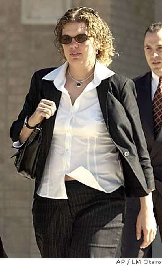 Megan Ambuhl leaves the judicial complex after her testimony in the court-martial of Army Spc. Charles Graner at Fort Hood, Texas, Thursday, Jan. 13, 2005. Graner is the accused ringleader in the Abu Ghraib prisoner abuse scandal. (AP Photo/LM Otero) Photo: LM OTERO