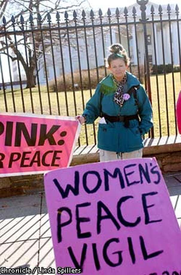 BERKELEY00a-C-05FEB03-MT-AP  SPECIAL SAN FRANCISCO CHRONICLE--Julia Wildwood, left foreground from Berkley Ca., works with the Code Pink group gathering signatures as they hold a silent vigil in front of the White House, Wednesday, Feb. 5, 2003. She is a member of the Women's Peace Vigil, joining them after walking and sometimes riding from California to protest the war in Iraq. (AP Photo/San Francisco Chronicle / Linda Spillers)