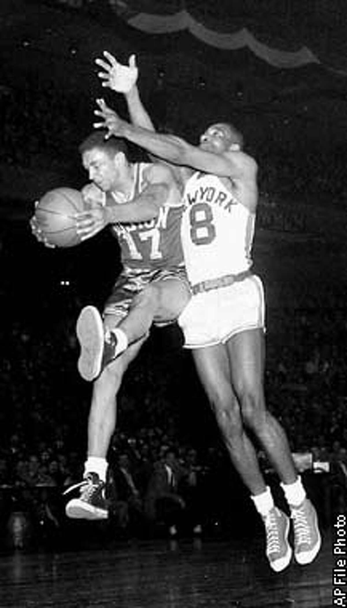 ** FILE ** Don Barksdale (17) of the Boston Celtics comes down with the ball after a scramble with Nat