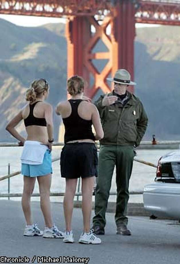 "SECURITYe-C-07FEB03-MT-MJM  Fort Point at the base of the GG Bridge was closed to cars and foot traffic due to the security alert. GGNRA Ranger Roger Goldberg informs joggers Kim Bates (left) and Courtney Daniels that they cannot pass the roadblock.  Security at the Golden Gate Bridge was increased due to the heightened security alert ""Orange"".  CHRONICLE PHOTO BY MICHAEL MALONEY Photo: MICHAEL MALONEY"