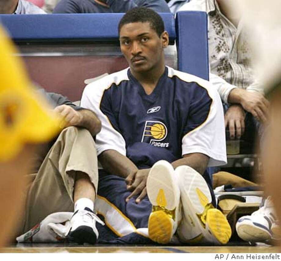 Indiana Pacers forward Ron Artest watches from the floor as his team plays the Minnesota Timberwolves in Minneapolis, Tuesday, Nov. 9, 2004. Artest did not play in the Pacers' 102-101 win. Artest was cleared by his coach to play for the Indiana Pacers on Friday night after being benched for two games for asking for time off because of his busy schedule. (AP Photo/Ann Heisenfelt) Sports#Sports#Chronicle#11/14/2004#ALL#5star##0422463765 Photo: ANN HEISENFELT