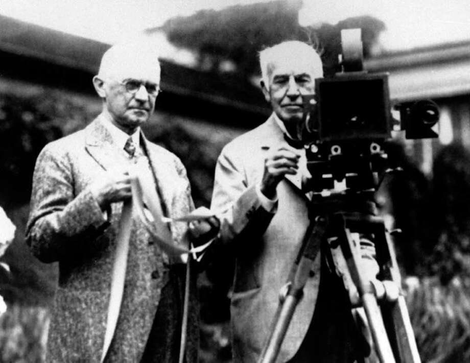 FILE - In this late 1920's file photo, Eastman Kodak Co. founder George Eastman, left, and Thomas Edison pose with their inventions. Edison invented motion picture equipment and Kodak invented roll-film and the camera box, which helped to create the motion picture industry. The glory days when Eastman Kodak Co. ruled the world of film photography lasted for over a century. Photo: AP / AP1919