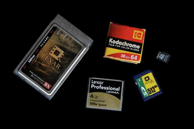 A Jan. 6, 2012 photo shows a roll of Kodachrome film is shown next to a variety of digital media flash cards in Rochester, N.Y.  Eastman Kodak Co. ruled the world of film photography for over a century. Then came competition from Japanese firms in the 1980s and a shift to the digital technology it pioneered but couldn't capitalize on and on Thursday Jan. 19, 2012 Kodak filed for Chapter 11 bankruptcy protection. Photo: David Duprey, AP / AP