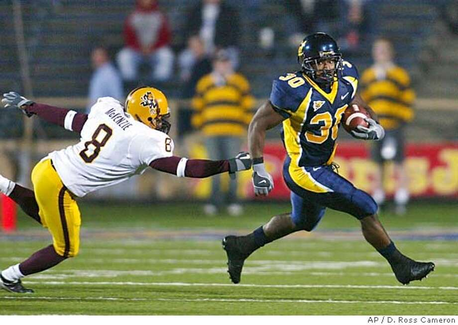 California running back J.J. Arrington, right, evades the tackle of Arizona State defender Chris McKenzie (8) during the first quarter Saturday night, Oct. 30, 2004, in Berkeley, Calif. (AP Photo/D. Ross Cameron) Sports#Sports#Chronicle#11/15/2004#ALL#5star##0422441906 Photo: D. ROSS CAMERON