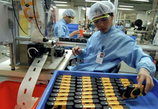 Chinese workers assemble disposable film cameras at a U.S.-based Eastman Kodak factory in Xiamen, southeastern China, Thursday, March 25, 2004. The factory is one of the company's biggest operations for disposable cameras aimed for export to oversea markets. (AP Photo/str) ** ONLINE OUT, CHINA OUT ** Photo: STR, AP / CHINATOPIX