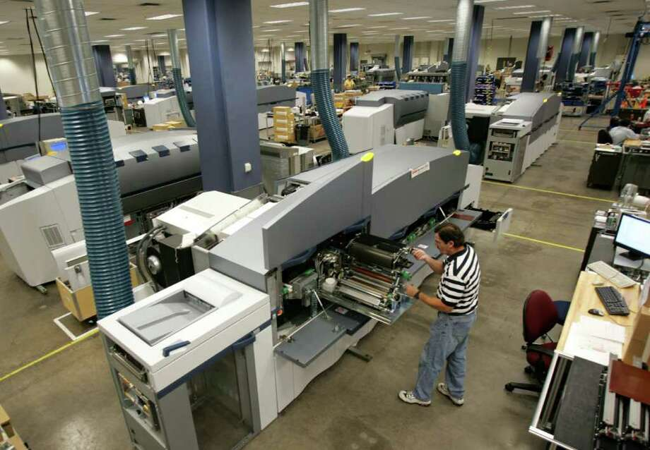 Eastman Kodak Co. employee Doug Kanous assembles a Kodak NexPress digital production printer at the  graphic communications plant in Rochester, N.Y., in this Aug. 1, 2006 file photo. Eastman Kodak Co. reported a narrower loss for its first quarter on Friday, May 4, 2007, its ninth deficit in the last 10 quarters as it applies some final cost-cutting touches to a drastic digital makeover. Photo: DAVID DUPREY, AP / AP