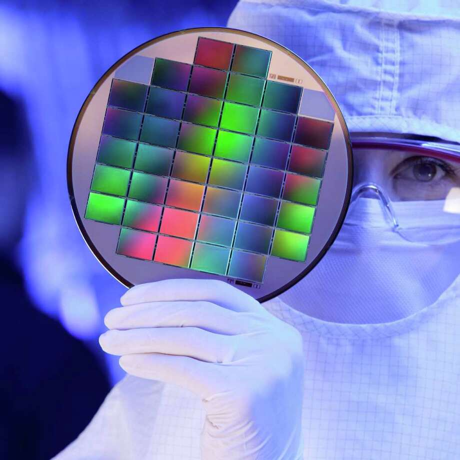 FILE -  In this undated file photo released by Eastman Kodak Company an unidentified Kodak technician displays image sensors embedded on a silicon wafer at Eastman Kodak Inc., in Rochester, N.Y. The glory days when Eastman Kodak Co. ruled the world of film photography lasted for over a century. Photo: Eastman Kodak Company, AP / AP2007