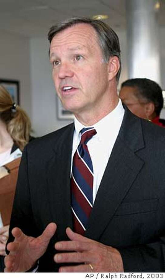 Rep. Christopher Cox, R-Calif., chairman of the House Select Committee on Homeland Security, talks with reporters at Boeing Field in Seattle, Friday, Oct. 3, 2003. Cox and other members of the congressional delegation are touring the Seattle area Friday and Saturday to see ports, military bases and other sites at risk of a terrorist attack. The bipartisan group also will meet with local officials and emergency responders. (AP Photo/Ralph Radford) Rep. Christopher Cox, R-Newport Beach, is leading the charge in the House to extend the moratorium on Internet taxes. CAT Photo: RALPH RADFORD