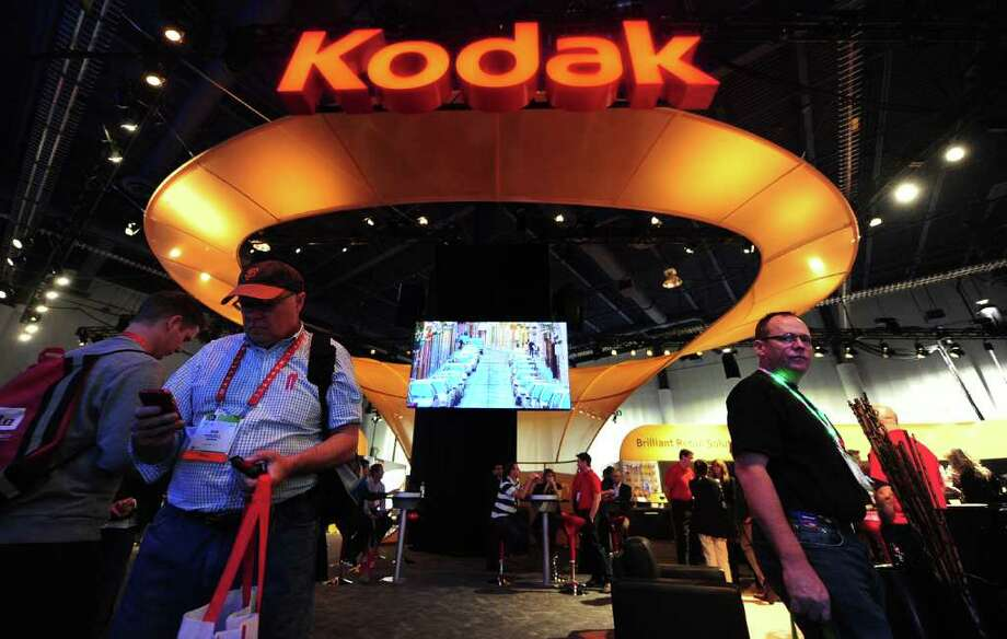 (FILES) - A file picture taken on January 11, 2012 shows people visiting the Kodak display at the International Consumer Electronics Show (CES) in Las Vegas, Nevada. US camera pioneer Eastman Kodak, which brought photography to the masses over a century ago, filed for bankruptcy early on January 19, 2012 after years of failing to keep pace with the digital age.  AFP PHOTO / Frederic J. BROWN Photo: FREDERIC J. BROWN, AFP/Getty Images / 2012 AFP