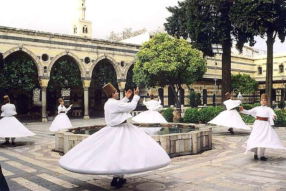 The Whirling Dervishes of Damascus (Syria) touring Fall 2004 in US with Ensemble Al-Kindi photo courtesy of Zamzama Mgmt  press info CindyByram@aol.com  212-545-7536 x 21 Datebook#Datebook#SundayDateBook#11/14/2004#ALL#Advance##0422458255