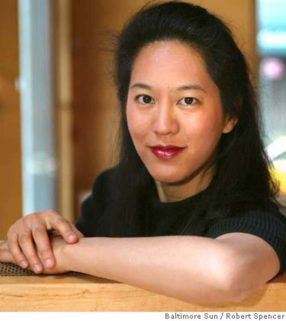 THIS IS A HANDOUT IMAGE. PLEASE VERIFY RIGHTS. Author Iris Chang has her picture taken, in her hotel lobby, in New York, Sunday, April 27, 2003. MANDATORY CREDIT--By Robert Spencer/BALTIMORE SUN HANDOUT PHOTO/VERIFY RIGHTS AND USEAGE