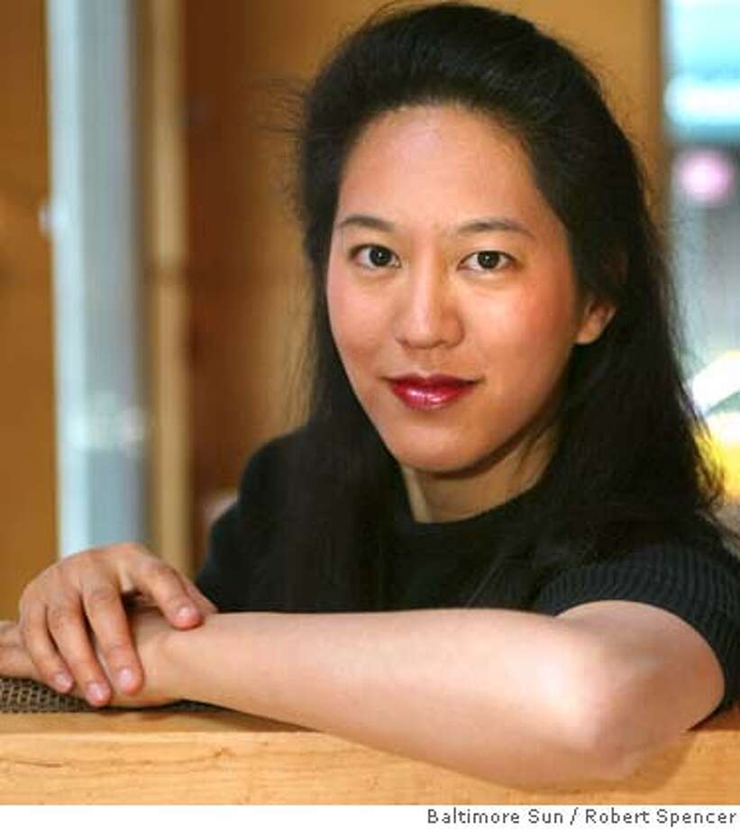 THIS IS A HANDOUT IMAGE. PLEASE VERIFY RIGHTS. Author Iris Chang has her picture taken, in her hotel lobby, in New York, Sunday, April 27, 2003. MANDATORY CREDIT--By Robert Spencer/BALTIMORE SUN  HANDOUT PHOTO/VERIFY RIGHTS AND USEAGE Photo: HANDOUT