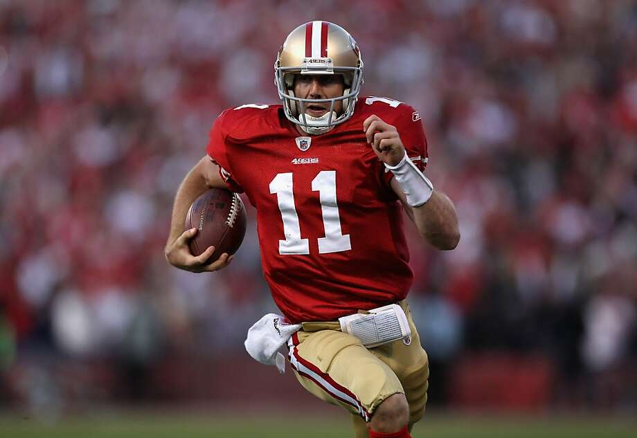 Alex Smith of the San Francisco 49ers runs in for a touchdown in the fourth quarter against the New Orleans Saints during the NFC Divisional playoff game at Candlestick Park on January 14, 2012 in San Francisco, California. Photo: Jed Jacobsohn, Getty Images