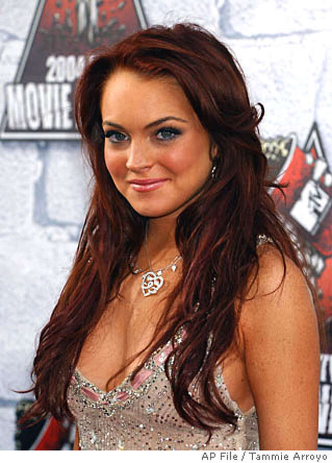 ** FILE ** Actress Lindsay Lohan arrives at the MTV Movie Awards in Culver City, Calif., in this June 5, 2004 file photo. Lohan was recovering at a hospital after being admitted with a high fever and headache, her publicist said Tuesday, Oct. 26,2004. (AP Photo/Tammie Arroyo, File) Photo: TAMMIE ARROYO