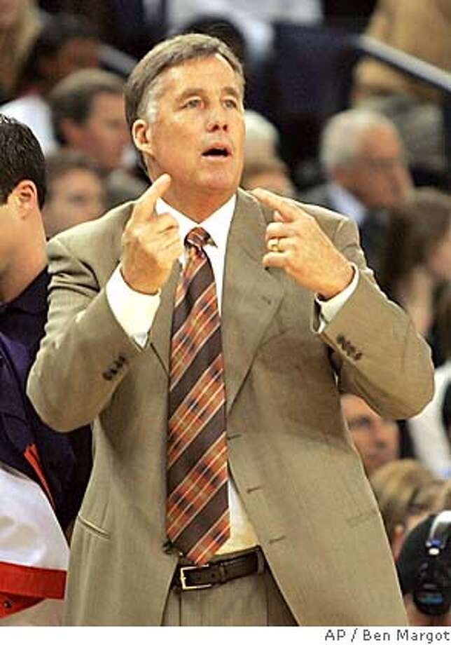 ** FOR USE WITH COLLEGE BASKETBALL PREVIEW ** Golden State Warriors' coach Mike Montgomery gives signals to his players from the sideline during the game with the Portland Trail Blazers Wednesday, Nov. 3, 2004, in Oakland, Calif. Montgomery has followed the lead of hundreds of starry-eyed youngsters and declared himself eligible for the huge paychecks and tantalizing challenges of the NBA, crossing San Francisco Bay to take over the Warriors. College coaches have a dim track record in this transition. But when the unpleasantness of recruiting, discipline and NCAA regulations becomes too much, many of the best college coaches can't resist the NBA. (AP Photo/Ben Margot) FOR USE WITH COLLEGE BASKETBALL PREVIEW Sports#Sports#Chronicle#11/15/2004#ALL#5star##0422451103 Photo: BEN MARGOT