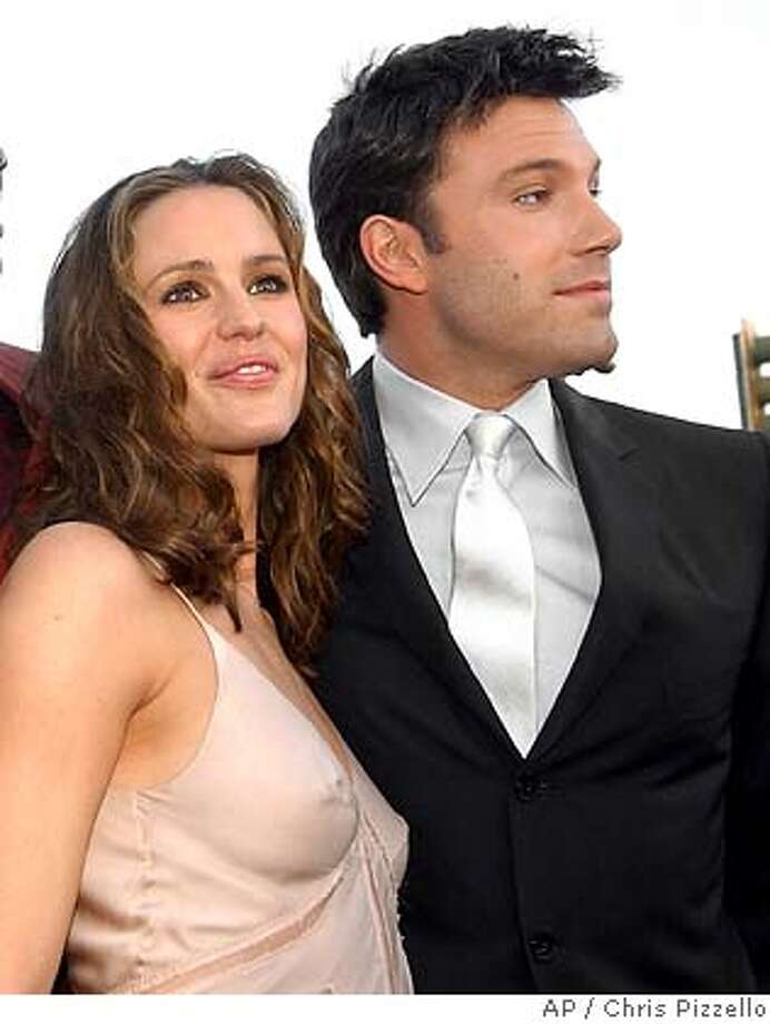 "**FILE**Jennifer Garner and Ben Affleck pose at a film premiere in the Westwood section of Los Angeles, on Feb. 9, 2003. The ""Alias"" star and Affleck, her boyfriend, are expecting their first child in November, according to published reports this weekend.(AP Photo/Chris Pizzello) Photo: CHRIS PIZZELLO"