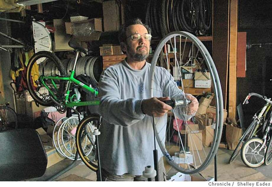 "PENSIONERS28083se.JPG Rich Lesnik is an avid bicyclist and retired mechanic at United Airlines who is working two part-time jobs doing bike repair and making bike tires in his ""Retirement"" to make up for benifit and pension cuts from United. (Photographed in his garage where he makes the bike tires.)  Photo taken on 04/01/05, in San Francisco, CA.  Photo SHELLEY EADES / The San Francisco Chronicle MANDATORY CREDIT FOR PHOTOG AND SF CHRONICLE/ -MAGS OUT Photo: SHELLEY EADES"