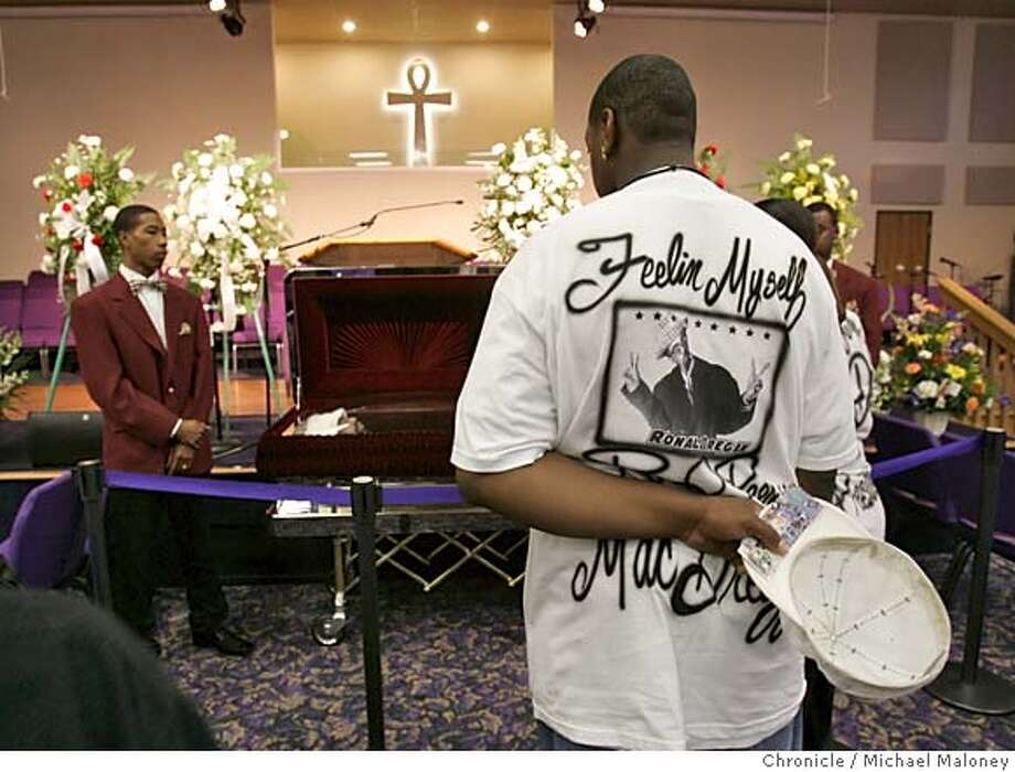MACDRE_022_MJM.jpg  Derrick Johnson of Vacaville wore a custom designed t-shirt for the occasion and took off his cap as he viewed the body.  Hundreds of Mac Dre fans stoood in line to view the slain Vallejo-bred rapper Andre Hicks, 34, known as Mac Dre at a church in Fairfield. Police in Kansas City are investigating why he was shot in what appeared to be a planned attack from a stolen car during a concert tour Nov. 1. There has been an outpouring of mourning from fans on hip-hop stations. A public viewing was held Tuesday from noon to 5 p.m. at Mount Calvary Baptist Church in Fairfield. The family is holding a private memorial service. Photo by Michael Maloney / San Francisco Chronicle MANDATORY CREDIT FOR PHOTOG AND SF CHRONICLE/ -MAGS OUT Metro#Metro#Chronicle#11/10/2004#ALL#5star##0422458862 Photo: Michael Maloney