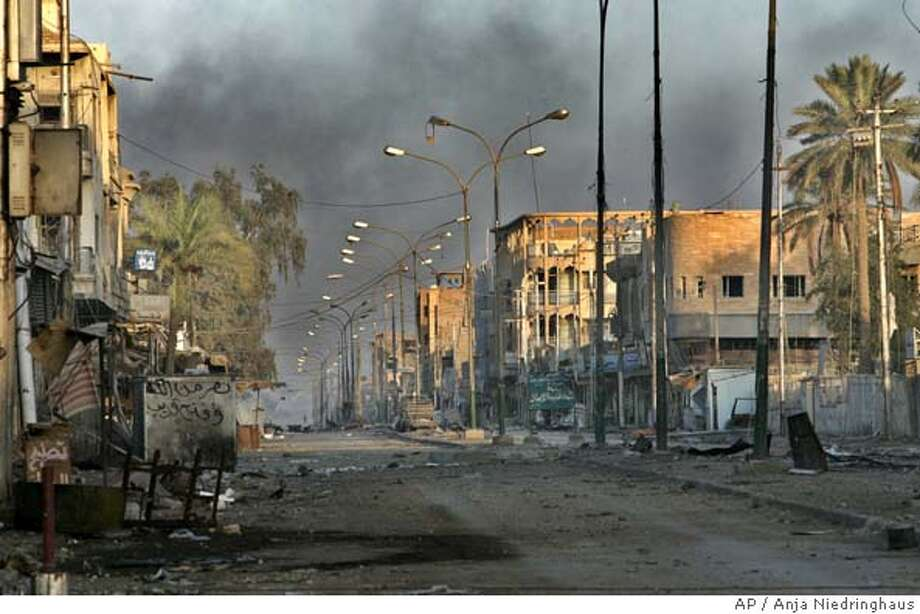 A deserted street in the western part of Fallujah, Iraq, Saturday, Nov. 13, 2004. About 80 percent of the city was said to be under U.S. control, with insurgents pushed into a narrow corner. But the battle has claimed at least 24 American lives and wounded about 170 U.S. troops, and violence has now spread to other Sunni Muslim areas of Iraq.(AP Photo/Anja Niedringhaus) Photo: ANJA NIEDRINGHAUS