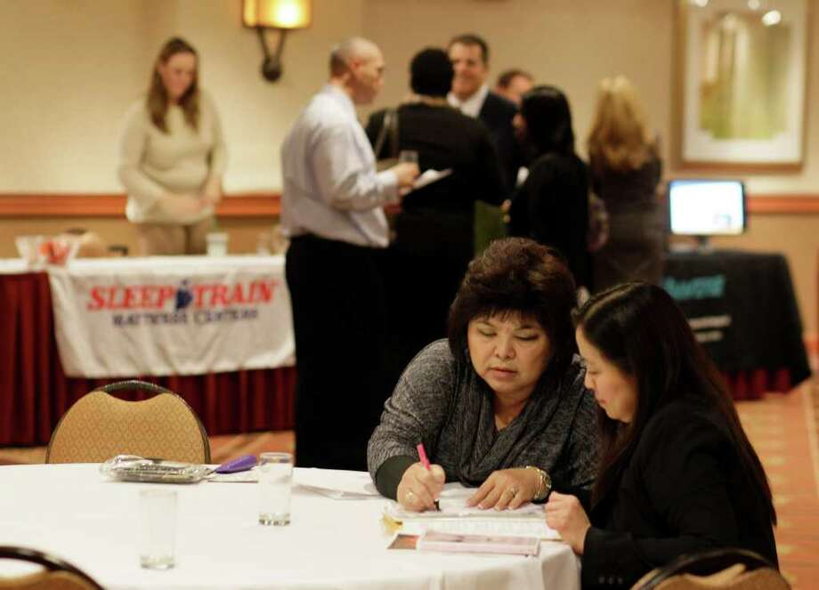 Fewer layoffs, lower inflation lift economy - Houston Chronicle