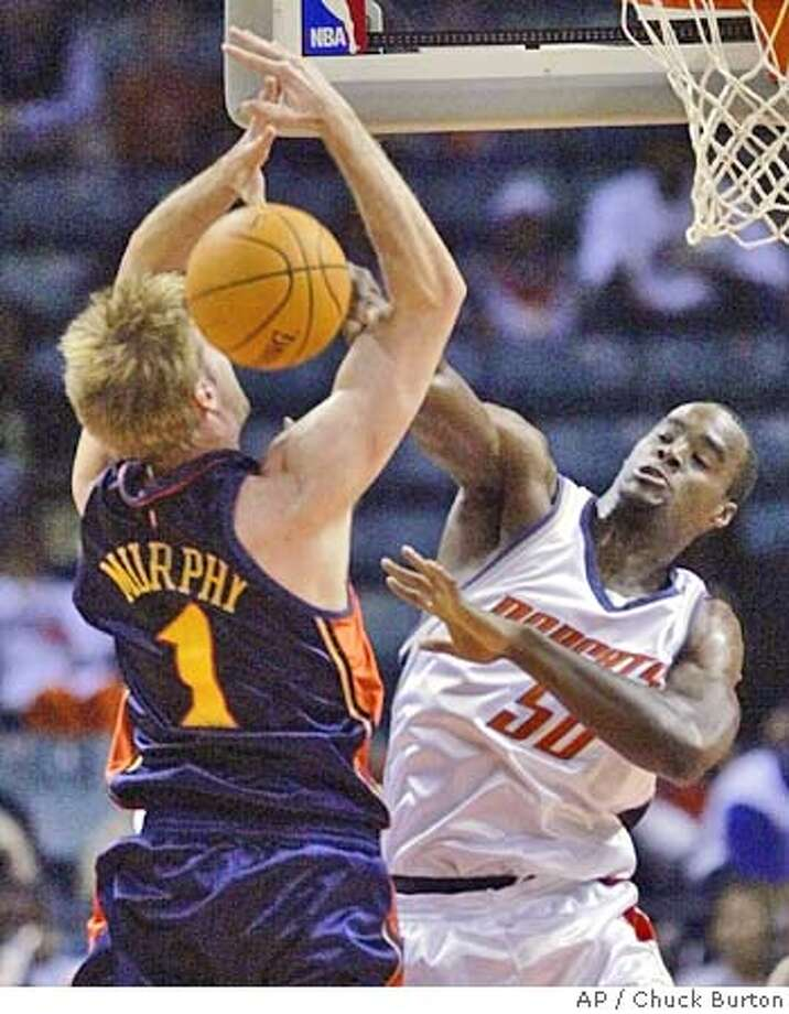 Charlotte Bobcats' Emeka Okafor (50) blocks a shot by Golden State Warriors' Troy Murphy (1) during the first half in Charlotte, N.C., Saturday, Nov. 13, 2004. (AP Photo/Chuck Burton) Photo: CHUCK BURTON