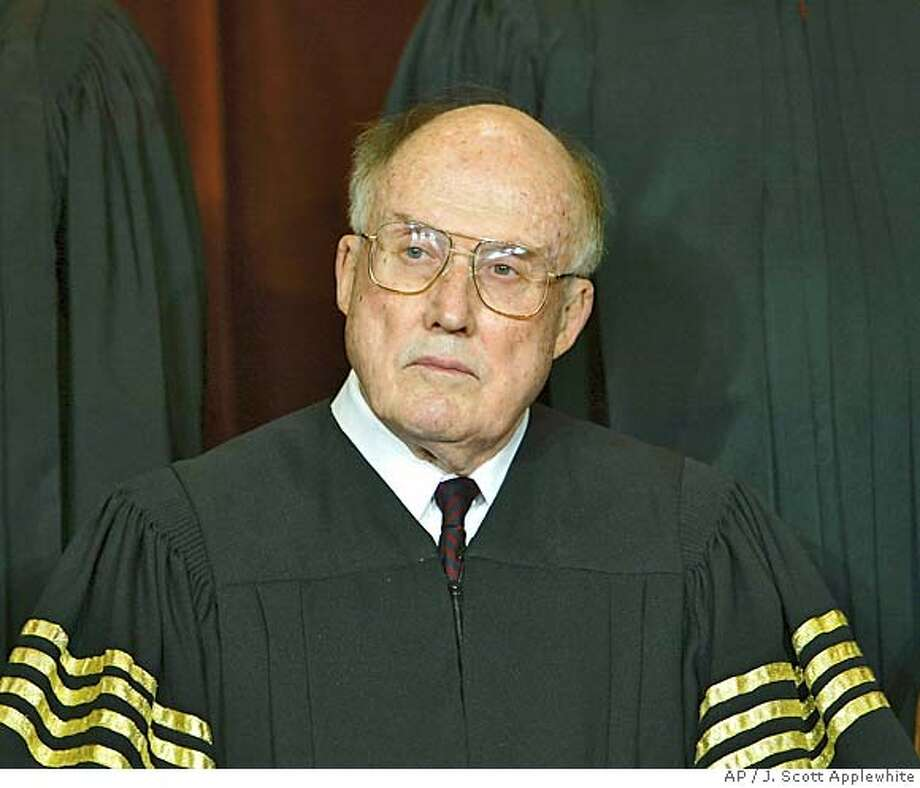 ** FILE ** Chief Justice of the United States William H. Rehnquist is seen in a file photo taken at the Supreme Court Building in Washington Dec. 05, 2003. Rehnquist disclosed Monday that he's undergoing radiation and chemotherapy for thyroid cancer and said he is delaying his expected return to the Supreme Court, a sign he may have a more serious form of the illness. (AP Photo/J. Scott Applewhite, File) Ran on: 11-02-2004  Chief Justice William Rehnquist's treatment plan points to an aggressive type of cancer, experts said. Ran on: 11-02-2004  Chief Justice William Rehnquist's treatment plan points to an aggressive type of cancer, experts said. DEC. 5, 2003 FILE PHOTO Nation#MainNews#Chronicle#11/10/2004#ALL#5star##0422443935 Photo: J. SCOTT APPLEWHITE