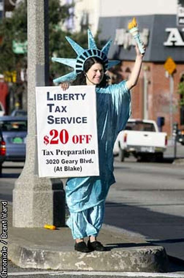 Denise Jameson uses a liberty costume to advertise a tax preparation service. By Brant Ward/Chronicle Photo: BRANT WARD