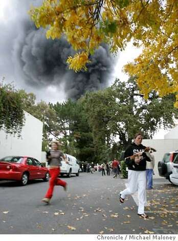 Adri Riley (cq) (left) and Sarah Potter run with their pet dogs out of the Diablo Pointe apartment complex at 1450 Creekside Drive in Walnut Creek.They were told to evacuate because of fear of further explosions. (note : they did not live at this complex but rather one just across the street.  A gas line explodes killing two members of a work crew as they were working on a construction project on South Broadway near Los Lomas High School.  Photo by Michael Maloney / San Francisco Chronicle Photo: Michael Maloney