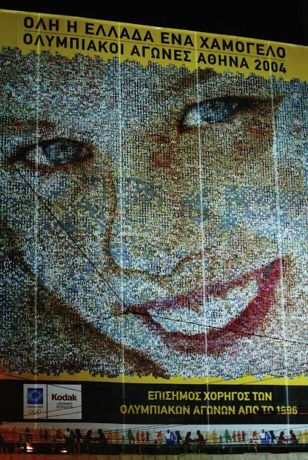 ATHENS - JUNE 17:   A general view of 'The Worlds Biggest Smile' the world record Kodak photo montage made from 16,608 photos of smiling Greek people constructed to welcome people to Athens ahead of next years Olympic Games in Consitution Square on June 17, 2003 in Athens, Greece. Photo: Stu Forster, Getty Images / 2003 Getty Images