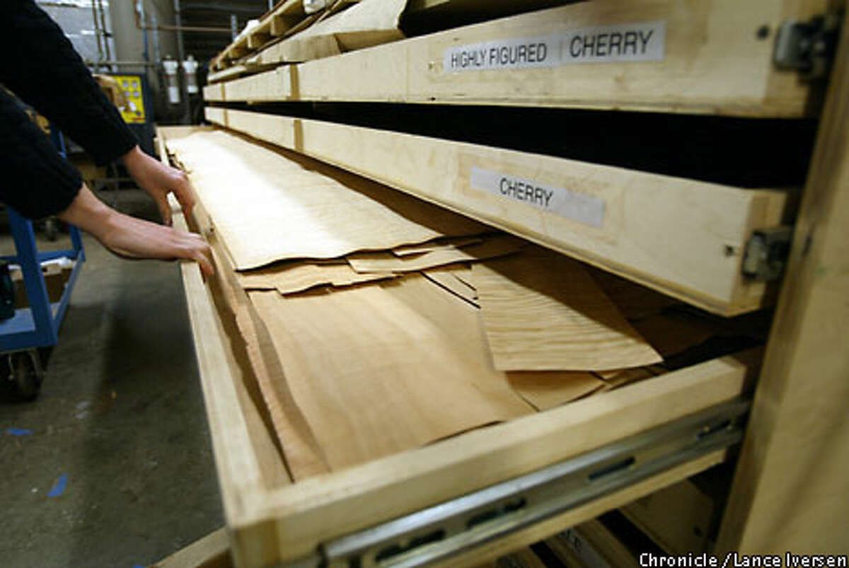 Just a veneer: Berkeley Mills has drawers full of exotic imported woods such as wenge, bubinga, sapele momele, ebony and cherry to use as accents. Chronicle photo by Lance Iversen
