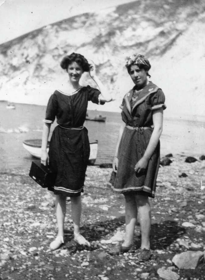 August 1911:  Two bathing belles enjoy a sunny day on the beach at Lulworth Cove in Dorset, maybe they have been using their  Kodak camera. Photo: Hulton Archive, Getty Images / Hulton Archive