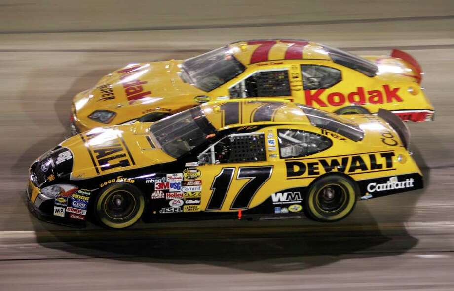 BRISTOL, TN - AUGUST 27:  Matt Kenseth driver of the #17 DeWalt Power Tools Ford passes Travis Kvapil driver of the #77 Kodak/Jasper Eng. & Trans. Dodge during the NASCAR Nextel Cup Series Sharpie 500 on August 27, 2005 at the Bristol Motor Speedway in Bristol, Tennessee. Photo: Nick Laham, Getty Images / 2005 Getty Images