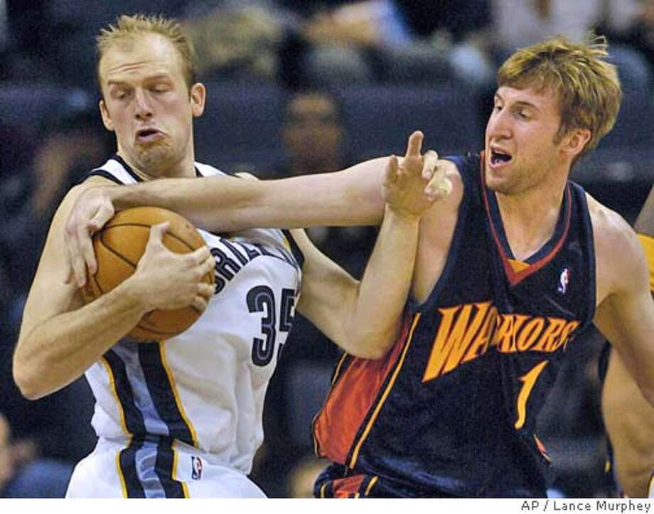 Golden State Warriors' Troy Murphy (1) reaches for a rebound against Memphis Grizzlies' Brian Cardinal (35) during the first quarter Friday, Nov. 12, 2004, in Memphis, Tenn. (AP Photo/Lance Murphey) Photo: LANCE MURPHEY
