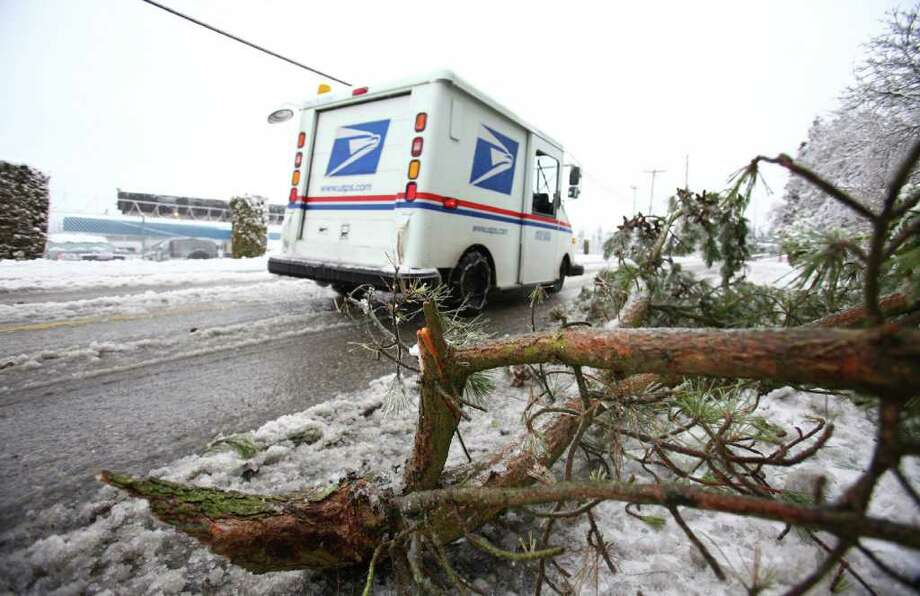 A tree branch sit along Military Road South after falling into the road on Thursday, January 19, 2012. An ice storm brought tree branches and power lines down across the region. Photo: JOSHUA TRUJILLO / SEATTLEPI.COM