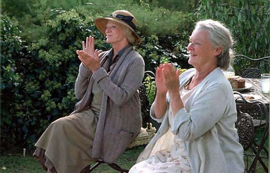 """In this photo provided by Roadside Attractions, Ursula (Judie Dench) and Janet (Maggie Smith) Widington are two sisters that have their peaceable Cornwall existence disrupted in 1936 when they take a young Polish violinist into their care in """"Ladies in Lavender."""" (AP Photo/ Roadside Attractions/Tom Collins) Photo: TOM COLLINS"""