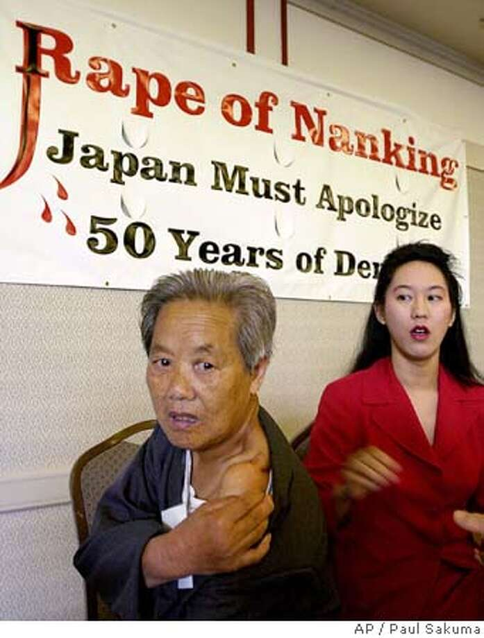 "** FILE ** Cuiping Ni, 75, shows off her scar as Iris Chang, right, author of ""The Rape of Nanking,"" looks on during the opening of the conference, ""50 Year of Denial: Japan and Its Wartime Responsibilities,"" in San Francisco, Friday, Sept. 7, 2001. Chang, a best-selling author who chronicled the Japanese occupation of China and the history of Chinese immigrants in the United States, has died of a self-inflicted gunshot at age 36. The official cause of death has not been released, but investigators concluded that Chang shot herself in the head, officials said. She lived in San Jose with her husband, Brett Douglas, and their 2-year-old son, Christopher. (AP Photo/Paul Sakuma) Metro#MainNews#Chronicle#11/12/2004#ALL#5star##0422460885 Photo: PAUL SAKUMA"