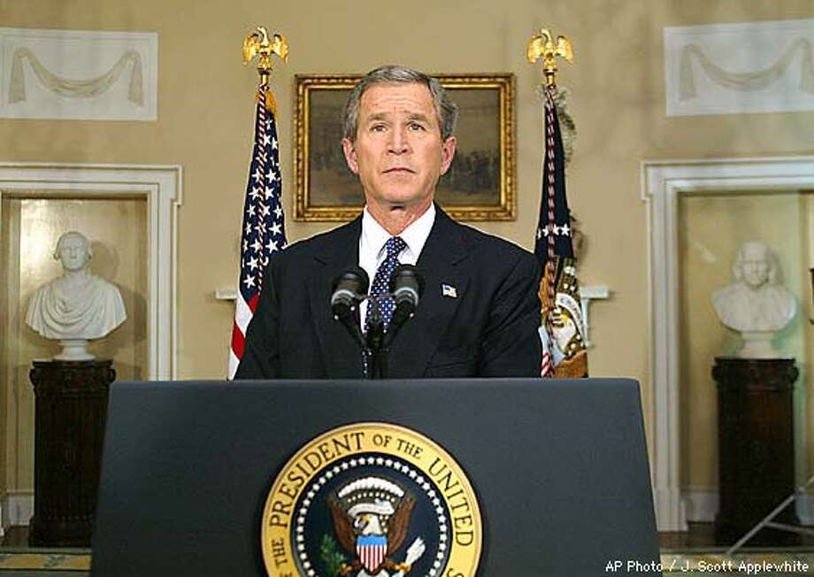 President Bush stands quietly in the Cabinet Room of the White House in Washington, after a televised response on the Space Shuttle crash, Saturday, Feb. 1, 2003. The Space Shuttle Columbia, with six Americans and the first Israeli astronaut aboard, disintegrated on its reentry to the atmosphere around 9 am Eastern Standard Time today. (AP Photo/J. Scott Applewhite) Photo: J. SCOTT APPLEWHITE