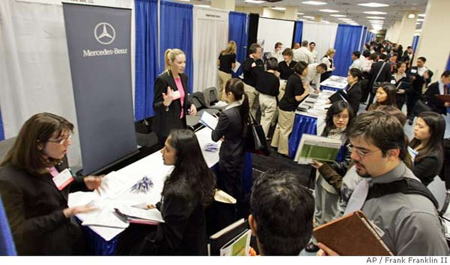 Job seekers interview with companies at the 4th Annual Asian Diversity Career Expo at New York's Madison Square Garden Friday May 6, 2005. Employers ramped up hiring in April, adding 274,000 jobs, enough to hold the nation's jobless rate at 5.2 percent. (AP Photo/Frank Franklin II) Photo: FRANK FRANKLIN II